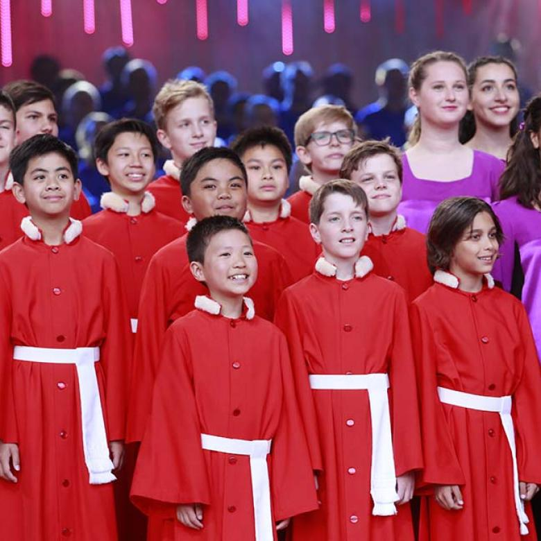 Photo of National Boys Choir and Australian Girls Choir singers on the stage